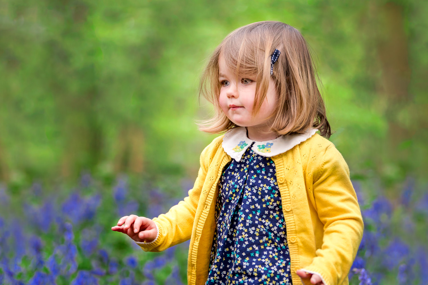 Girl walking through bluebells