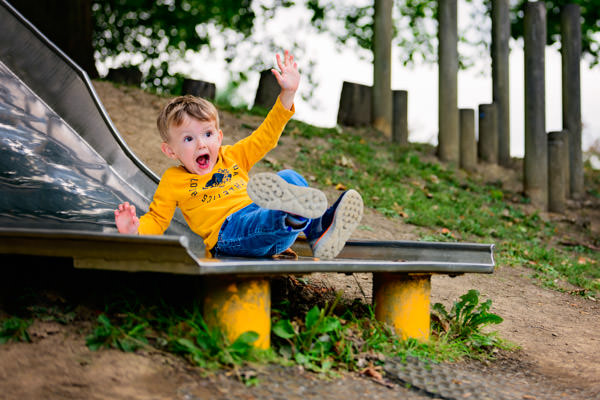 Boy hurtling down a slide