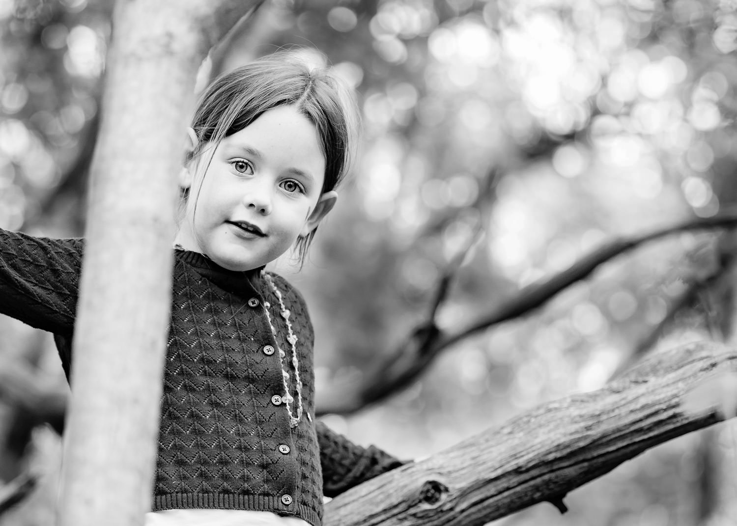 Black and white portrait of girl in tree