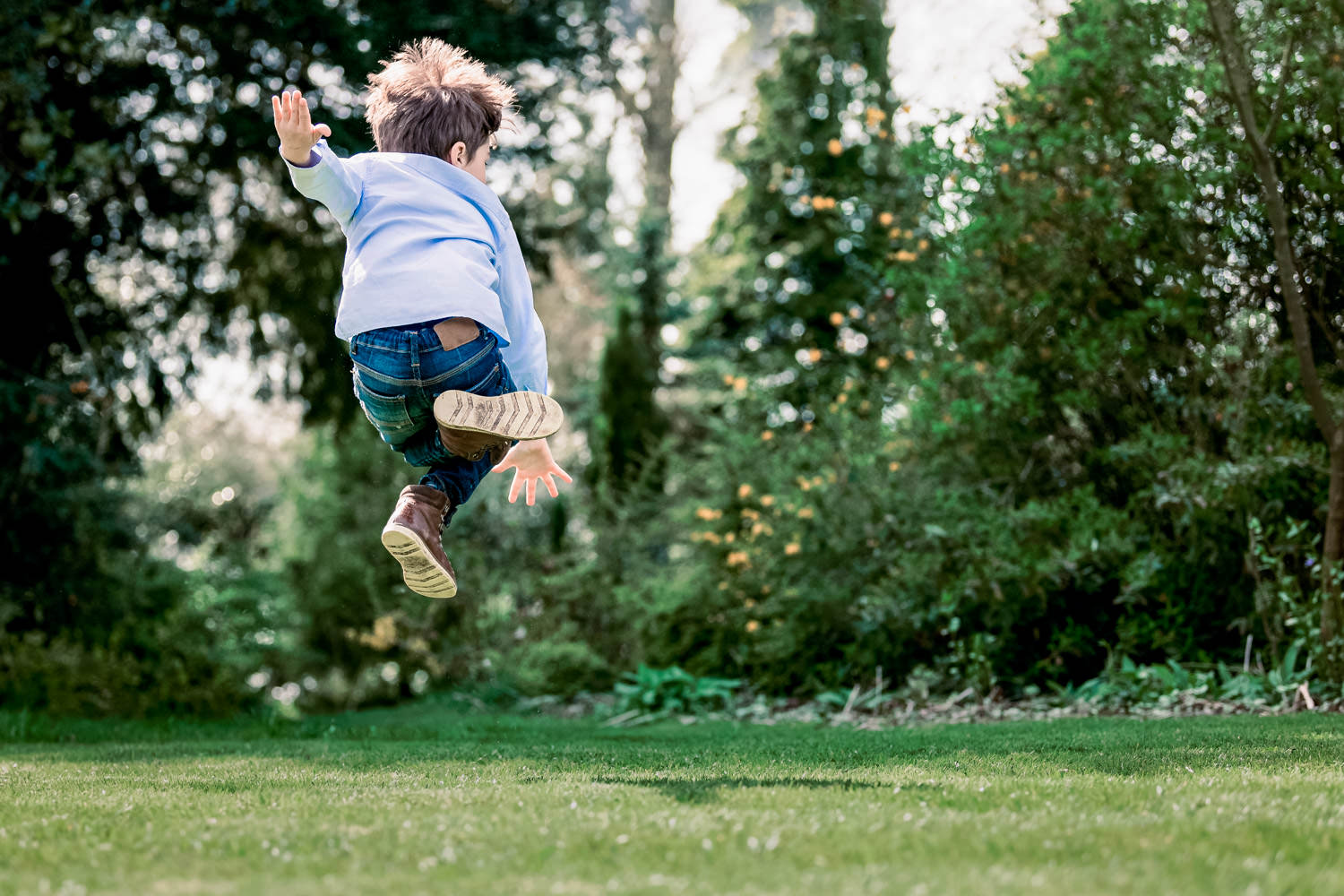 Boy jumping in mid air during family photo shoot