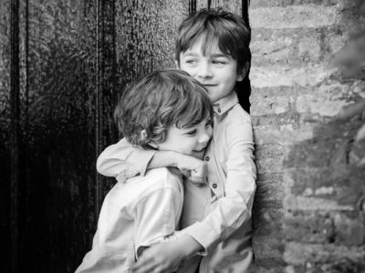 Brothers hugging during family photo shoot
