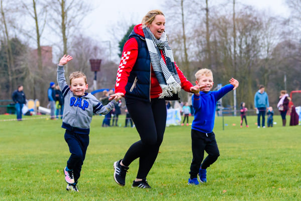 Boys running and waving with mother at Kids Run Free Banbury