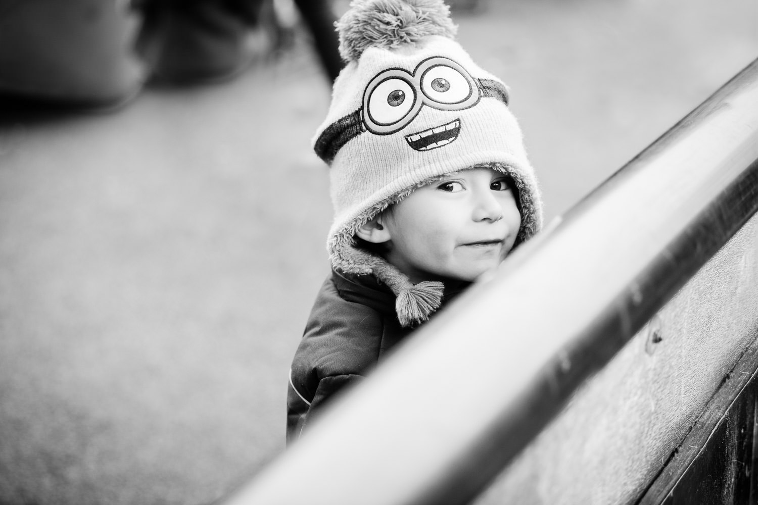 Boy wearing minions bobble hat at nursery