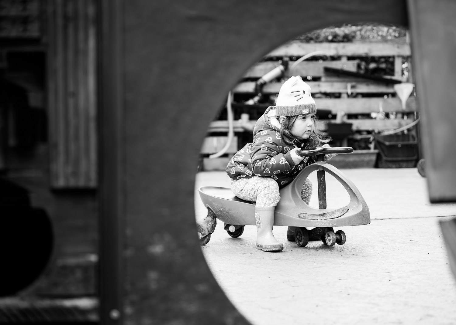 Girl on scooter at nursery