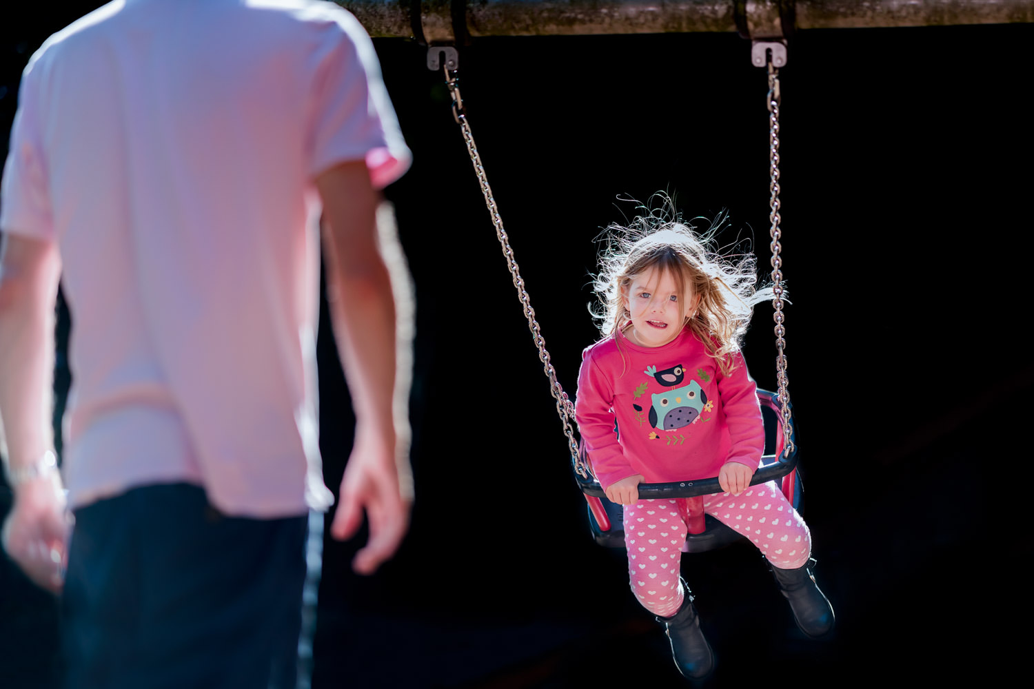 Girl on swing with hair backlight