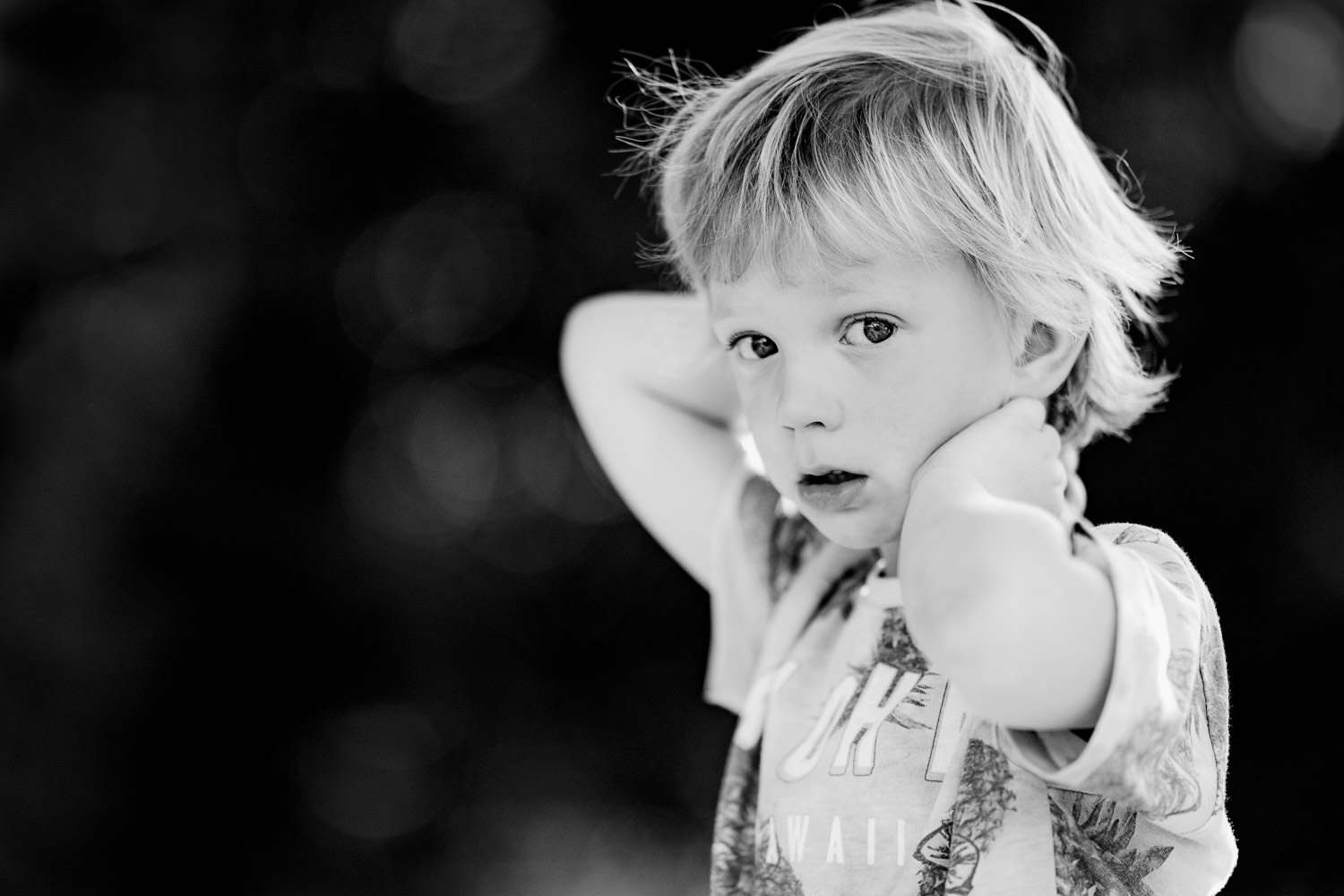 Boy looking emotional with arms behind head