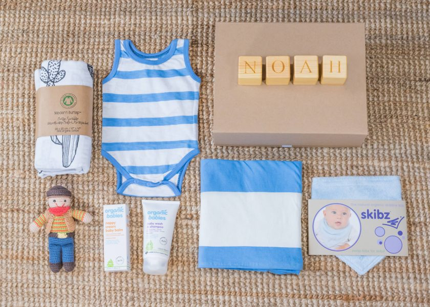 Flat lay image of baby gift box and contents