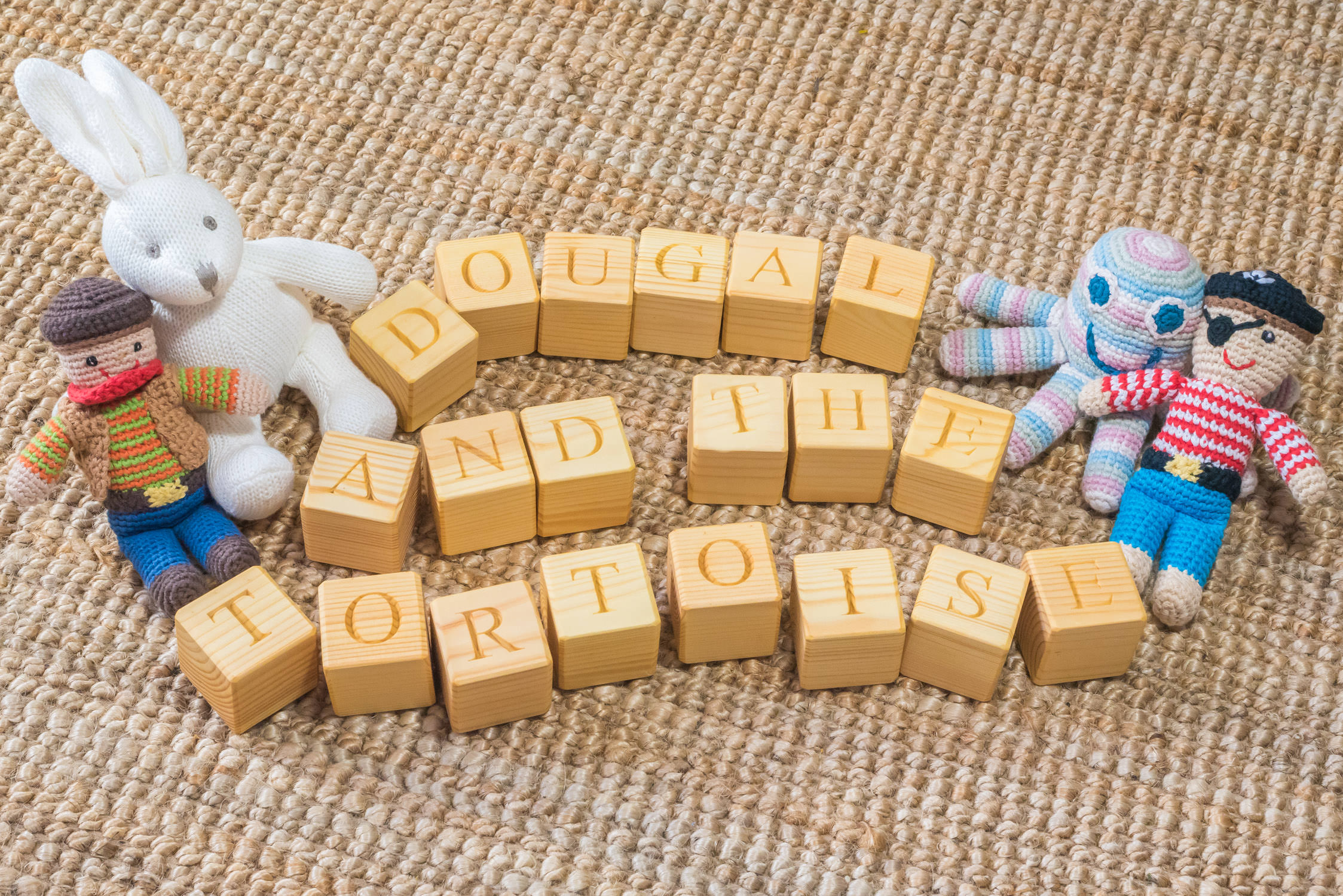 Children's wooden blocks with knitted toys