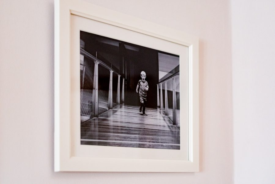 Framed black and white print on wall