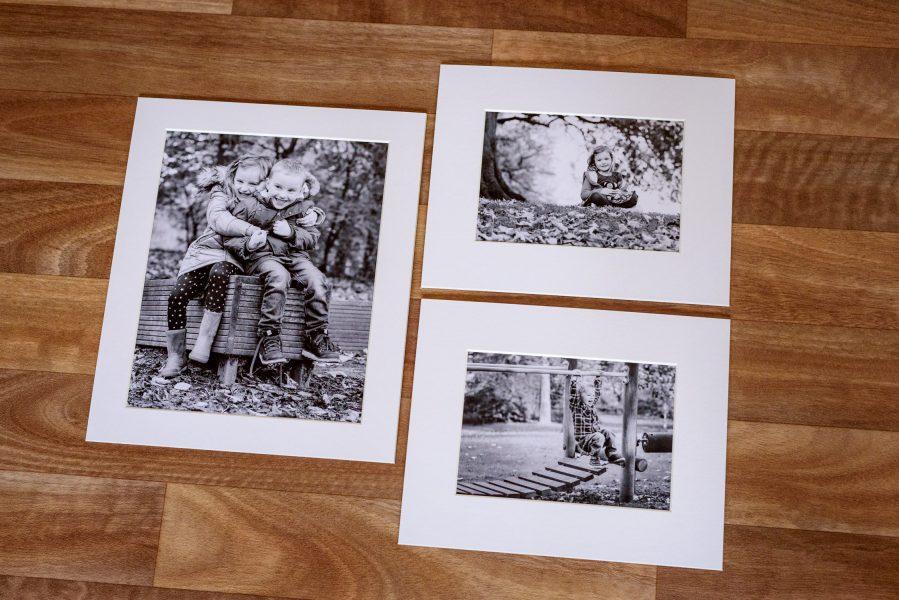 Three mounted photos