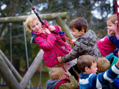 six children on a swing during a mini shoot