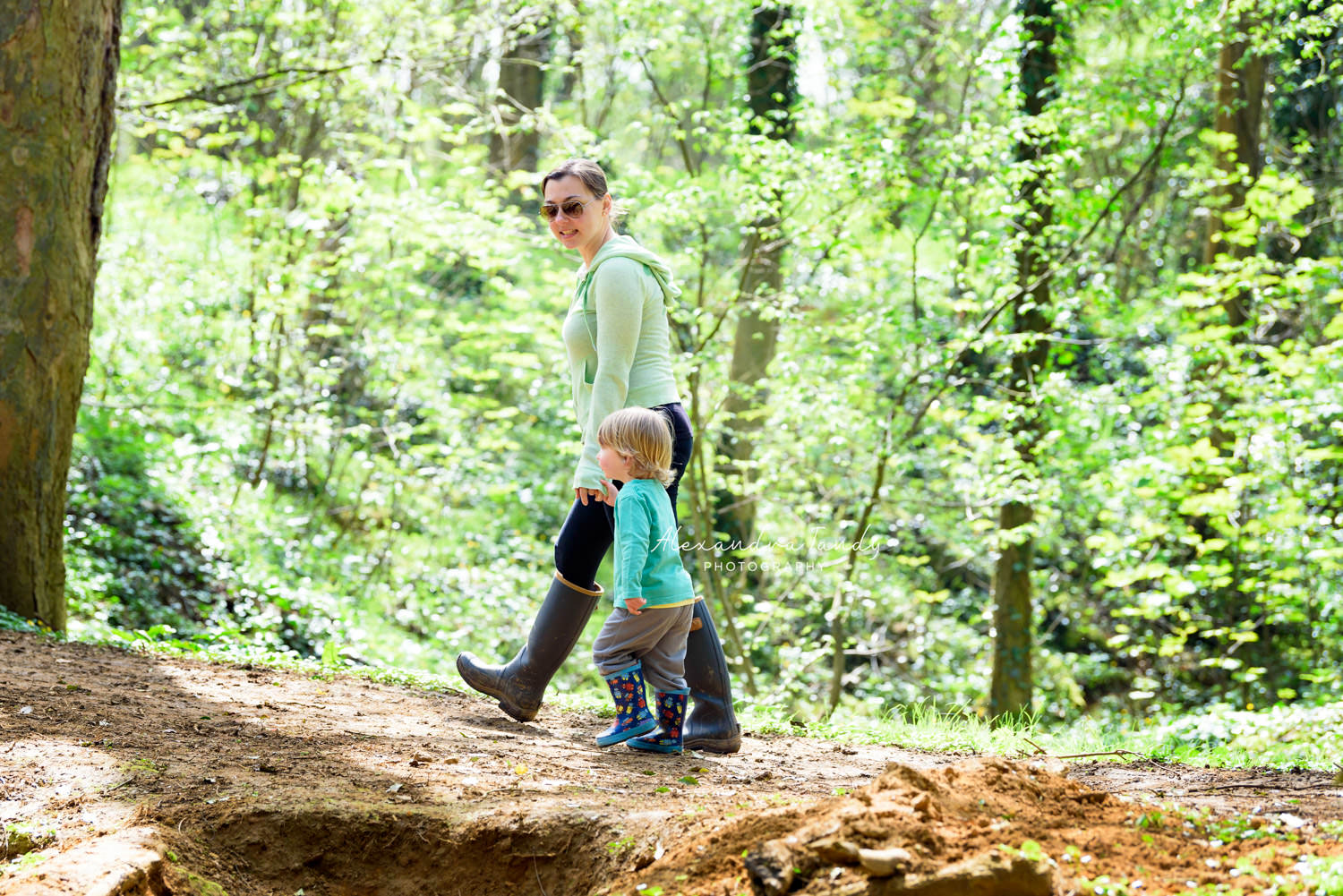 Family Photographer capturing mother and son waling in woodland