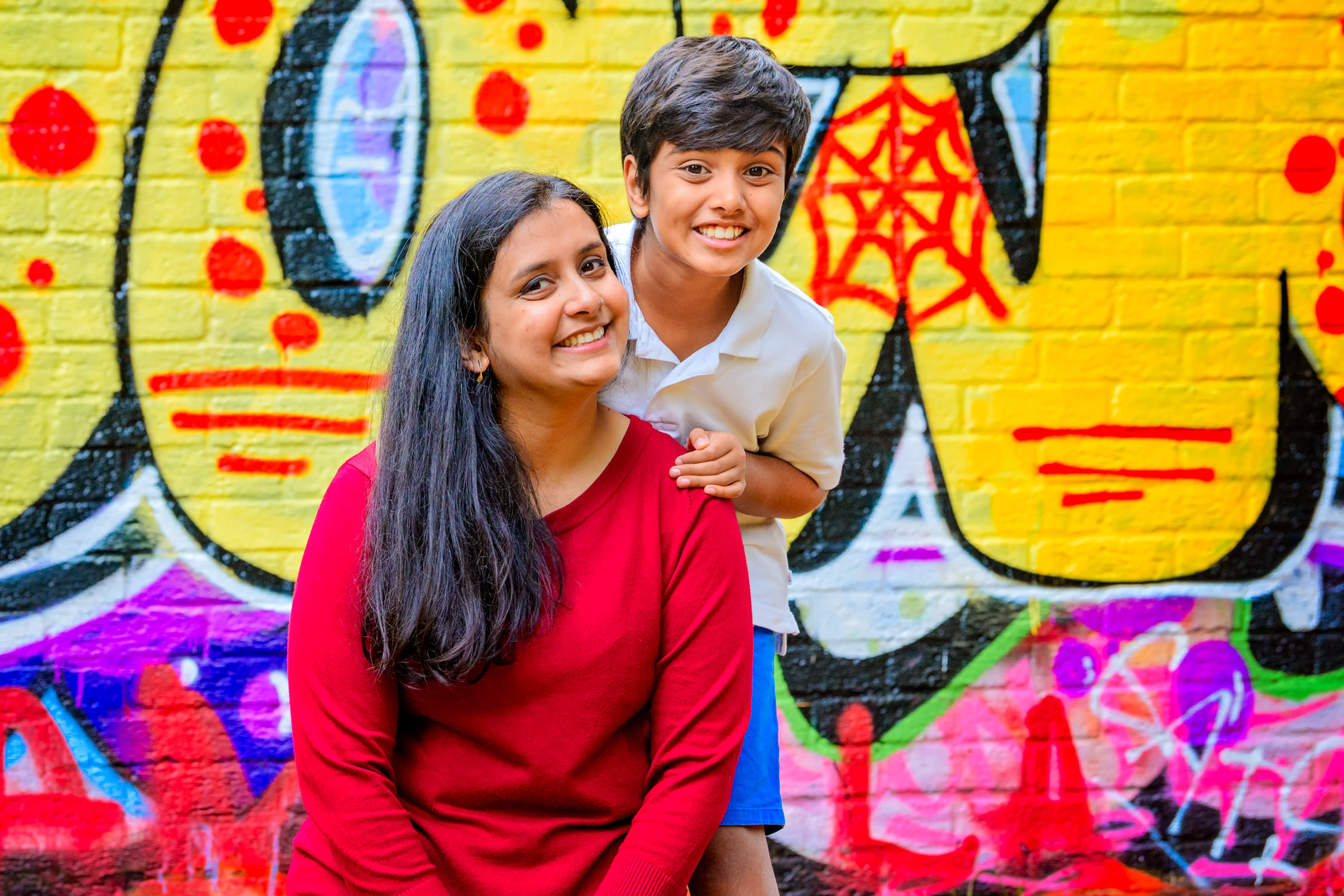Nephew and aunt in front of grafitti