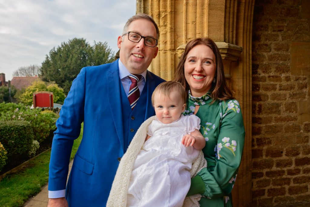 Family Christening portrait shot of mother, father and baby