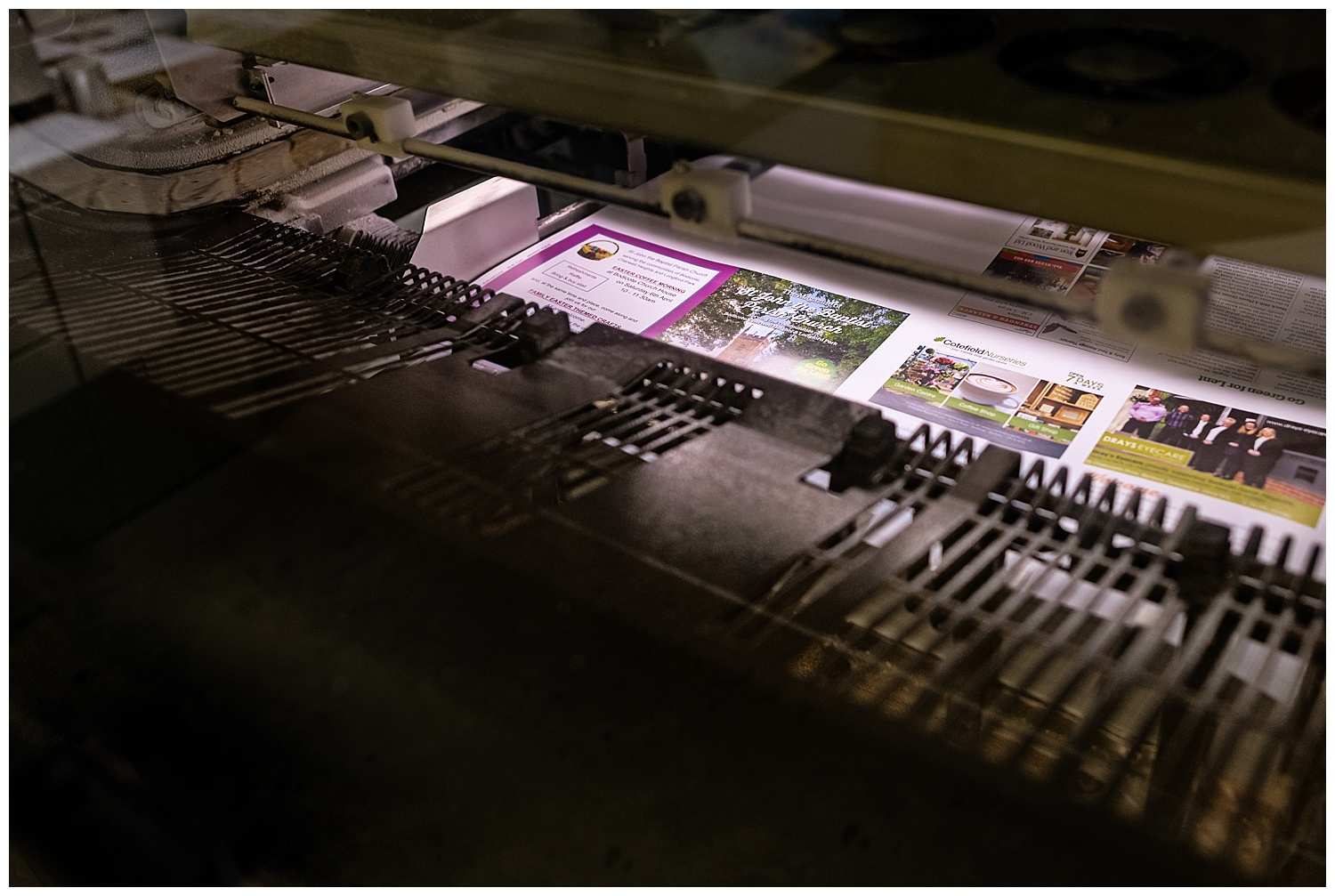 Printing press creating the front cover of a magazine