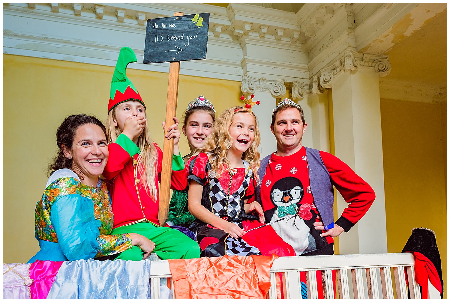 Family dressed in pantomime clothes and laughing out loud