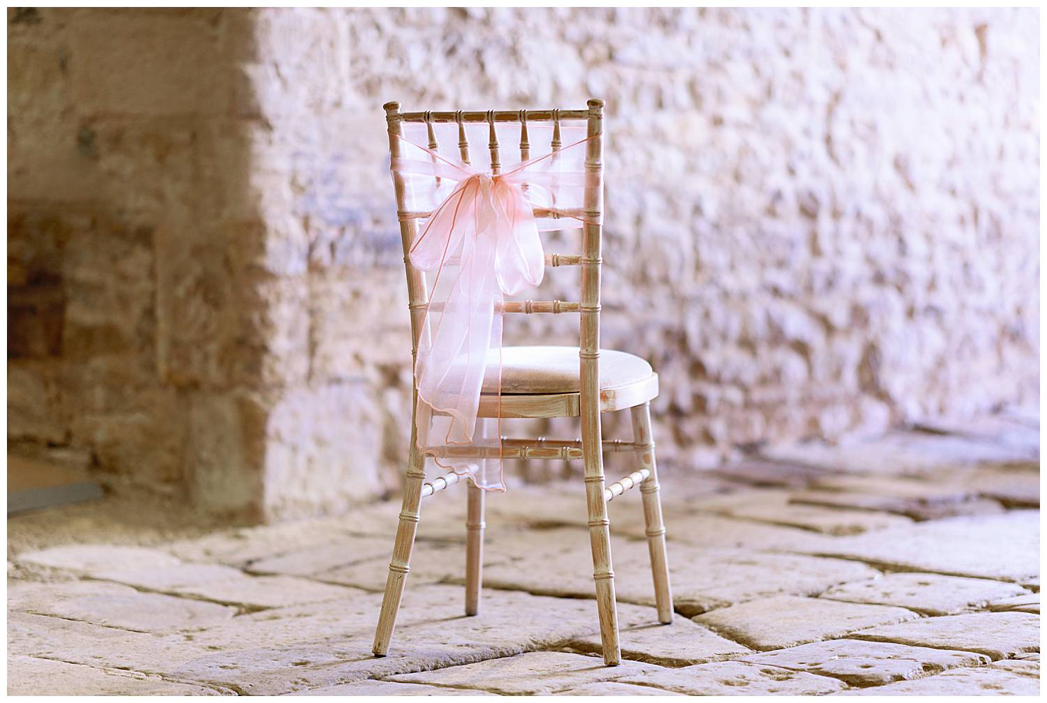 Wedding chair with soft pink bow