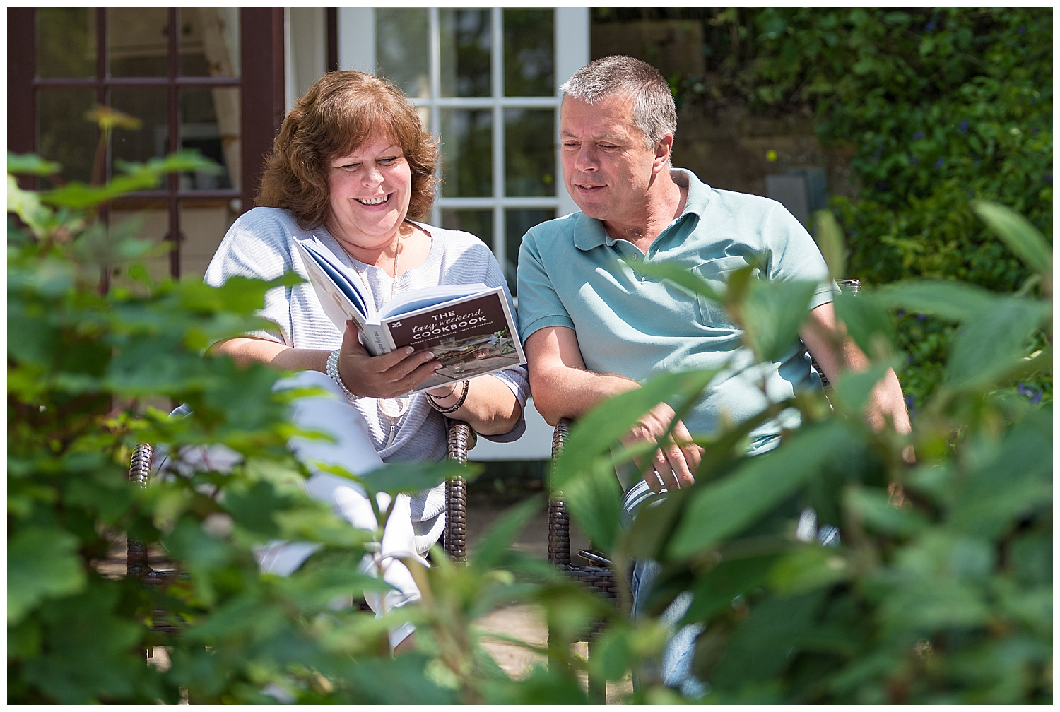Two adults sat reading a National Trust Cook Book